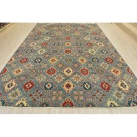 This is a Kazak rug hand-knotted in Pakistan, woven with an all wool pile on a cotton foundation. This rug is new and in excellent condition. These rugs are inspired and recreated from original antique Kazak rugs from the Caucasus region.