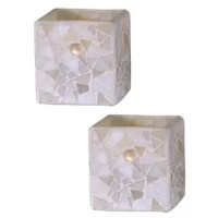 Vivid shades of white and beige make our 2-Piece Pastel Mosaic Art Glass Candle Holder Set a bright addition to any décor. The set features 2 square cup style candle holders. Each is crafted of art glass in variegated shades of beige and white. We added glass gems in the body to brighten any color when you add a lighted votive or tea light candle (candle not included). A lovely gift for any occasion or even for yourself, our 2-Piece Pastel Mosaic Art Glass Candle Holder Set is destined to...