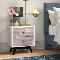 Whether acting as an end table in the living room or flanking your bed in the master suite, this nightstand is always a stylish stage. Founded atop four tapered legs for a hint of mid-century influence, its solid and manufactured wood frame takes on a contemporary clean-lined silhouette with rustic gray drawer fronts. Measuring 22.5'' H x 19.75'' W x 15.4'' D, it includes two drawers perfect for a few books and before-bed essentials.