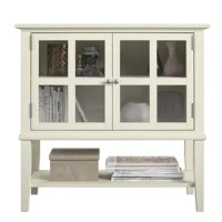 Get storage where you need it with the Dmitry 2 Door Accent Cabinet. Made of painted MDF and solid wood legs, the neutral finish can easily be added into your existing décor. The 2 glass doors feature a mullion frame for a decorative touch and adjustable euro hinges. The decorative molding and tapered legs give this Cabinet an elegant look for an instant upgrade for your living space. The top surface is perfect for displaying photos and decorations and the open lower shelf gives you extra...