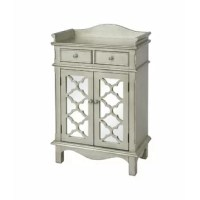 Two-door, two-drawer accent cabinet with one shelf Mirrored door fronts with Moroccan fretwork Hand-painted antique silver finish Three-sided top gallery and scalloped lower apron