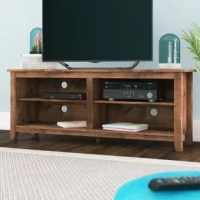 Bring some farmhouse style to your entertainment ensemble while keeping your movie collection and more organized with this eye-catching TV stand as a centerpiece! Crafted from manufactured wood, it features a clean-lined silhouette and boasts a natural wood finish with knots and grains for some classic character. Plus, it's four adjustable shelves each include cable management cutouts to help keep wires out of sight and out of mind. Measuring 23.6'' H x 60'' W x 15.75'' D, it supports a TV up...
