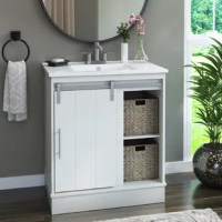 Get a quick bathroom makeover with this bathroom vanity that comes ready to install and has on-trend style to boot. A sliding barn door on track hardware offers a fun modern farmhouse look that you and guests will love. The planked design and metallic hardware add to chic design while one adjustable and one fixed shelf offer plenty of storage. Two included baskets provide you the option for modest storage and the perfect place to stow toiletries and bathroom essentials.