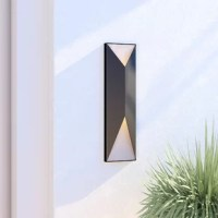 A perfect blend of industrial appeal and clean-lined contemporary design, this charismatic two-light LED pocket sconce lends distinctive style to your outdoor arrangement. Made from aluminum in a handsome matte black finish, this delightful design showcases a streamlined rectangular silhouette with angular cutouts and a contrasting metallic interior. Establish a hip, curated aesthetic on your front porch by rolling out an all-weather braided runner for a pleasant pop of pattern, then place a...