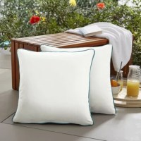 Welcome decorative detail to enhance any seating area with this set of two outdoor square pillows. The contrasting cording trim decorates these pillows with elegant character, allowing them to complement the look and feel of surrounding furniture and features. Filled with 100 percent recycled fiber and sewn closed, these pillows are durable and supportive through long-term use to ensure maximum comfort and enjoyment. The exteriors are UV and fade resistant to protect against wear and aging when...