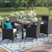 Create a peaceful haven in all four seasons with this Outdoor Complete 7 Piece Dining Set. The set can be used for both, indoor and outdoor use. Modern and stylish lines, this set offers comfortable and exceptionally stunning outdoor lounging. It has a modern style that enhances the look of the decor. Made from steel, the frame of this seating group provides durability and sturdiness. The woven resin wicker material enhances the aesthetic appeal of the seating group. This set is available in an...