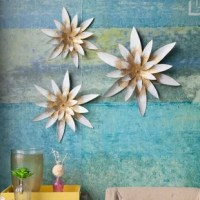 This lovely three piece set of wall hanging flowers in white with a gold center are sure to add charm to any space. Each flower is different in size, but not in details. The flowers are crafted entirely of metal and features a 3-D petal design. The flowers can hang individually, so you can choose to display them together or in different parts of your room.