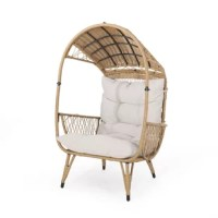 Cozy up in your backyard with a chair that will literally encompass you in delightful coziness. Featuring a gorgeous basket shape and intricate woven design, our outdoor chair not only gives your patio a modern look but also offers incredible comfort. This is constructed with beautifully wrapped wicker with a sturdy metal frame, allowing you hours of much-needed relaxation whenever you need it. Finished with plush and fresh water-resistant cushions, this piece is a truly extraordinary addition...