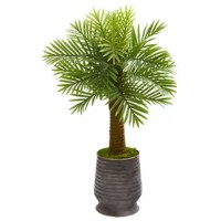 Create a soothing, tropical environment with the help of this artificial robellini palm tree designed with brightly colored, evergreen leaves sprouting from a sturdy, textured trunk. Standing 40in. high from a ribbed metal planter nestled with natural moss, this silk tree instantly spruces any space it inhabits. For over 75 years, they have been providing conscientious consumers with beautiful alternatives to natural decorations. Employing and advised by naturalists who understand the live...