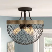 This collection's farmhouse chic design features a mesh wire bowl suspended from a simple steel hoop.