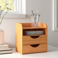 Marrying minimalist design with soothing, natural materials, this four-tier desk organizer is the perfect piece to keep your desktop clear of clutter and distraction. Crafted from eco-friendly bamboo in a light, natural stain, this essential organizer measures just 8.13'' H x 7.63'' W x 5'' D overall. Two drawers with cut-out handles are perfect for stowing away files and folders, while two open upper shelves are ideal for sorting mail or holding frequently-used desktop supplies.