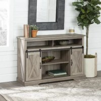 Whether stationed in your man cave or put on display in your living room, media stands are always a great addition. Take this one for example: Crafted from manufactured wood, this piece features two cabinets with barn-inspired door fronts, while three open shelves offer even more storage space. Awash in a neutral finish that allows it to blend with a variety of color schemes, this piece can support up to a 56