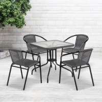 If you love hosting family and friends on your deck or need extra seating for the new dining patio of your cafe, this square table and 4 chair set is just what you need. The table's rippled designer glass top has a smooth surface for keeping items level. The rattan edge band complements the chairs and adds just the right touch for a stylish cohesive look. The lightweight chairs feature a curved back, comfortable rattan seat and integrated arms. Cross braces provide extra stability when sitting...