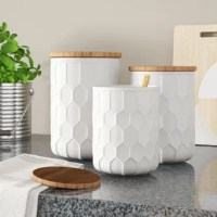 Mixing vintage and modern elements, this set of three kitchen canisters adds a dash of charm to the heart of your home. Their cylindrical ceramic bodies showcase a solid hue and a slightly raised honeycomb pattern for a touch of texture, while brown bamboo lids complete the look and offer a nod to natural style. With the capacity to hold, these pieces are perfect for stowing coffee beans, teas, and smaller snacks. Best of all, they're safe to go in the microwave, oven, and dishwasher as long...