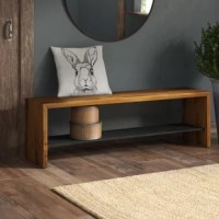 Benches in your home decor easily fuse function and fashion, offering statement-making appeal while providing an extra place to sit when you've got a full house for a fancy feast or a dinner party. Take this one for example: Crafted from Brazilian pinewood, it showcases a rectangular silhouette awash in a neutral finish. With a lower shelf that provides a place to display decorative favorites.