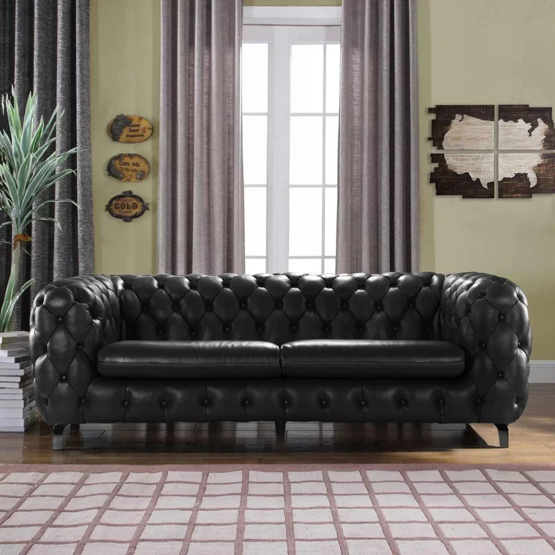 Yuliya Leather Chesterfield Sofa with Built In Shelves   Joss   Main Yuliya Leather Chesterfield Sofa with Built In Shelves