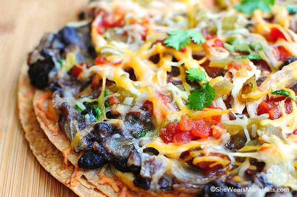 These Mexican Black Bean Pizzas are the perfect for lunch or appetizers and they couldn't be easier to make.