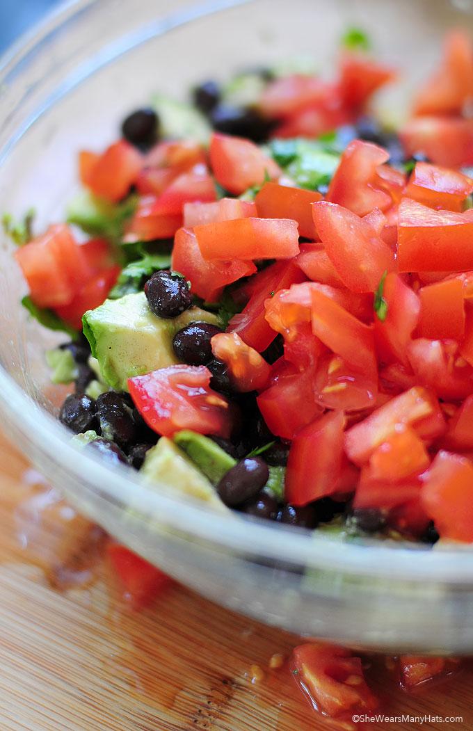 Black Bean Salad with Avocado and Tomato Recipe shewearsmanyhats.com