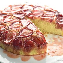 strawberry upside down cake with one slice cut oout