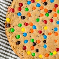 closeup of baked cookie cake showing colorful candies on top