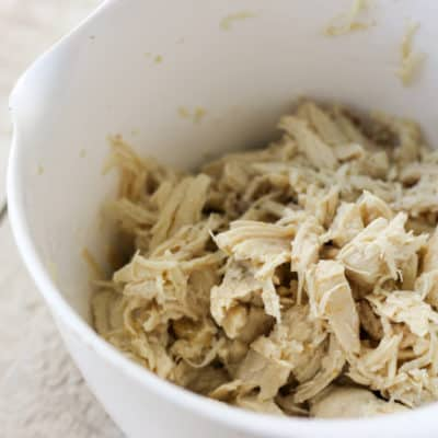 Shredded chicken breast | Make a batch of Crockpot Express Chicken Breast and get meal prep done for the week all at once! Instructions for cooking frozen chicken breasts included!