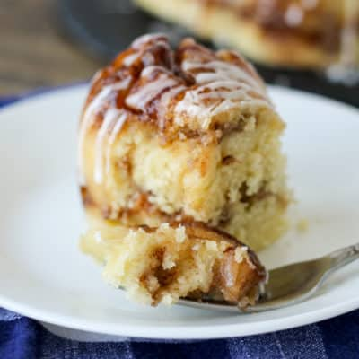 Chunks of tart apples, a sweet glaze and a brown sugar crackle on top make this Crockpot Express Apple Fritter Cake a delicious dessert that's ready in less than an hour (without heating up the kitchen!)