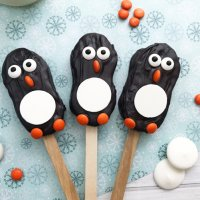"""Celebrate winter, Christmas and all things """"penguin"""" with these easy Penguin Nutter Butters! They are an adorable no bake treat perfect for cookie exchanges or fun with the kids."""