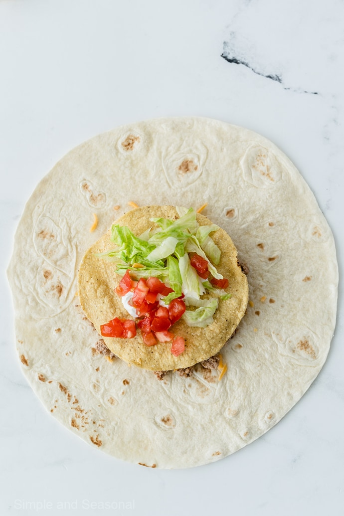 lettuce and tomato on tostada shell