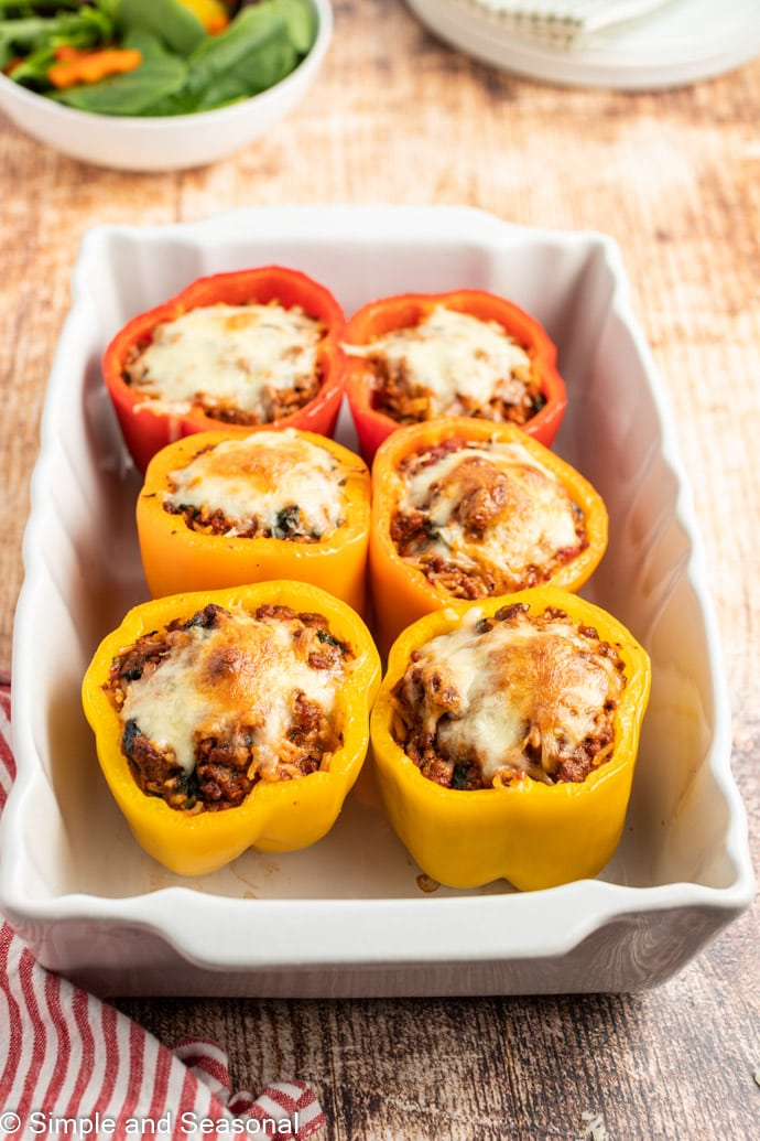 baked stuffed peppers in a white pan