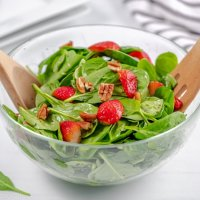 large salad bowl filled with spinach strawberry salad
