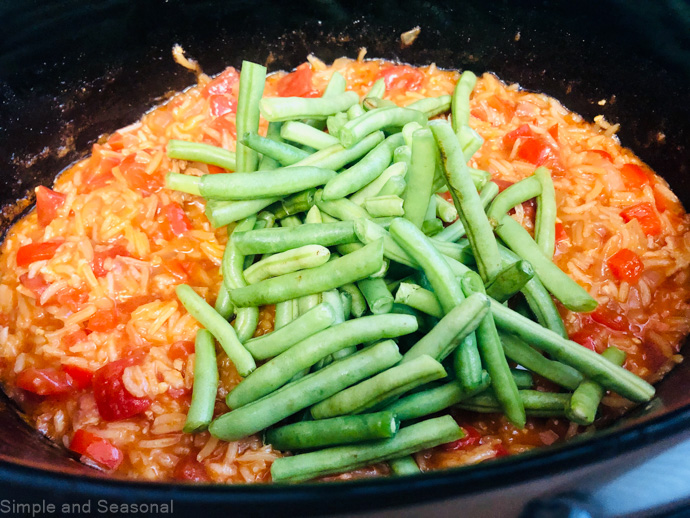 fresh green beans added to chicken and rice mixture