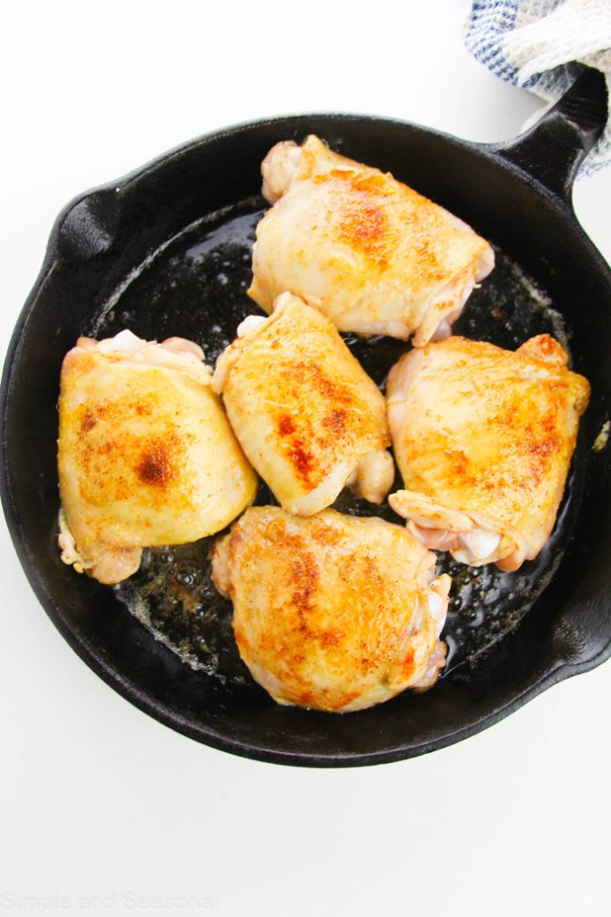 seared chicken thighs in a skillet