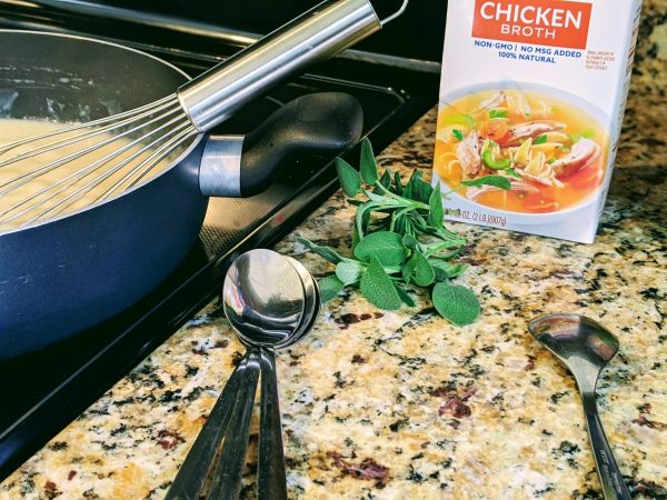chicken broth on countertop with various tools
