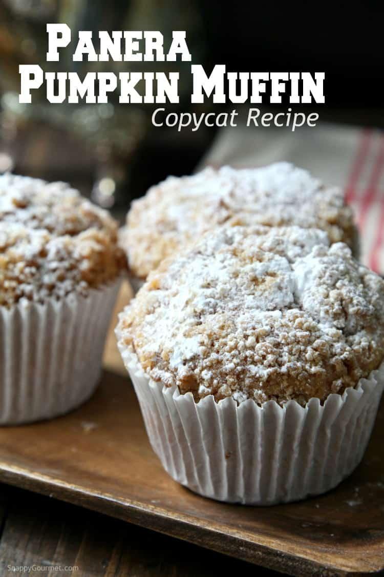 jumbo panera copycat pumpkin muffins sprinkled with powdered sugar on wood tray