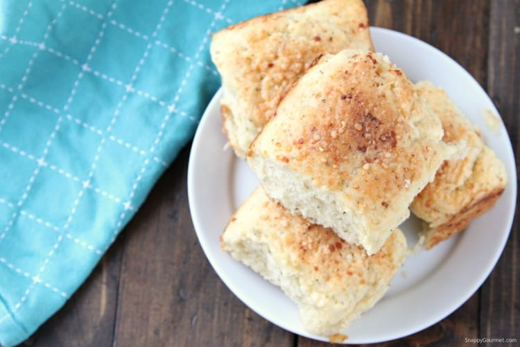 top of dinner rolls with parmesan cheese