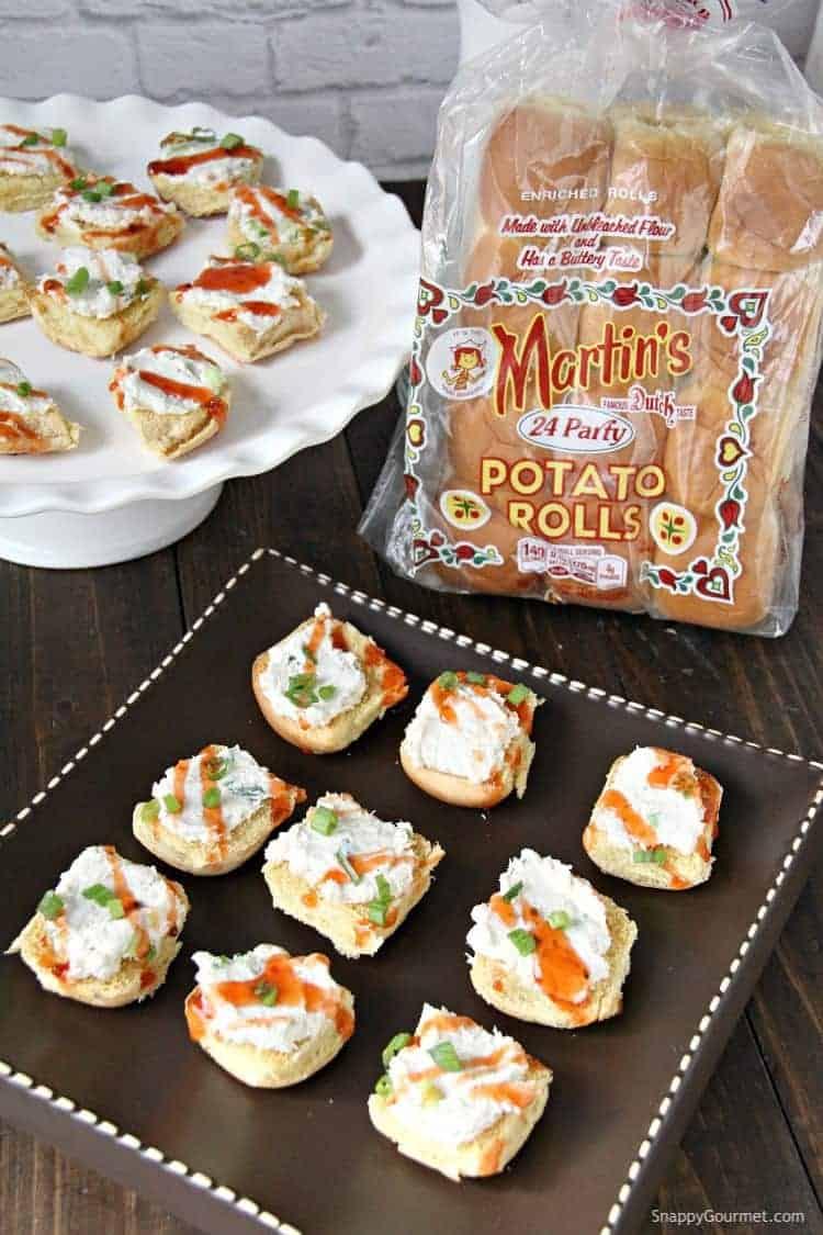 Crab Rangoon Crostini on serving platter with Martin's rolls