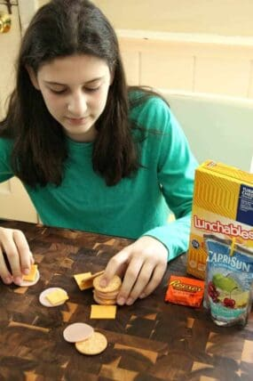 Girl building with Lunchables