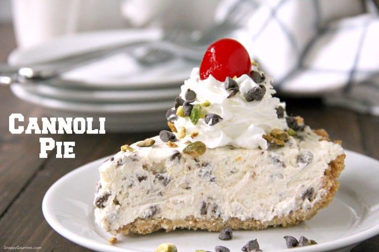 slice of cannoli pie with whipped cream and maraschino cherry