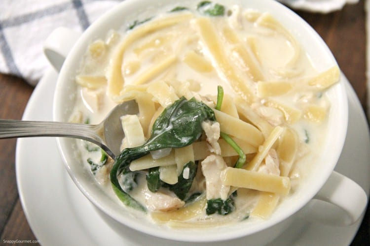Chicken Alfredo Soup with spoon in bowl