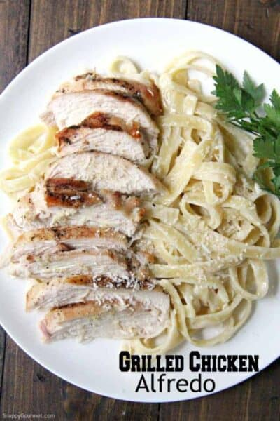 homemade Grilled Chicken Alfredo Pasta with parsley on plate