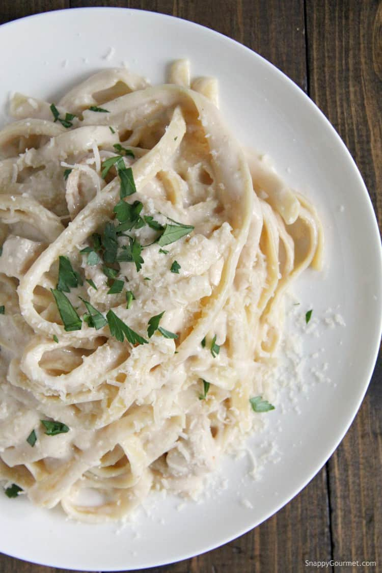 Creamy Instant Pot Chicken Alfredo on white plate