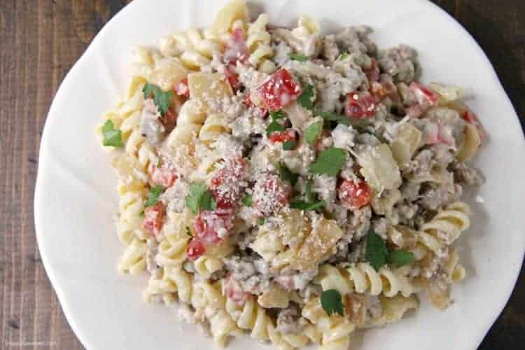 Sausage Alfredo Pasta with spiral pasta on plate