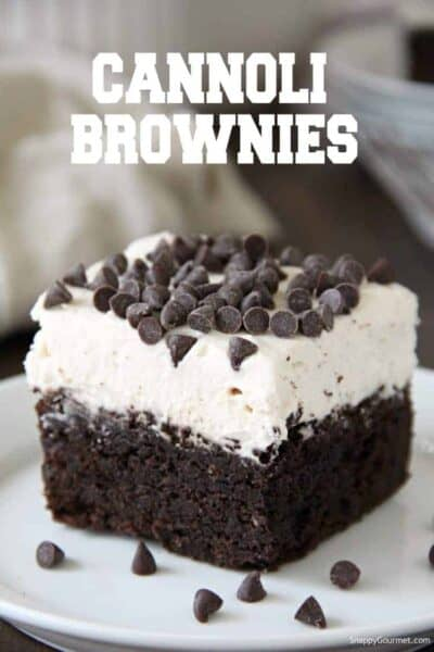 Cannoli Brownie with frosting and chocolate chips on plate
