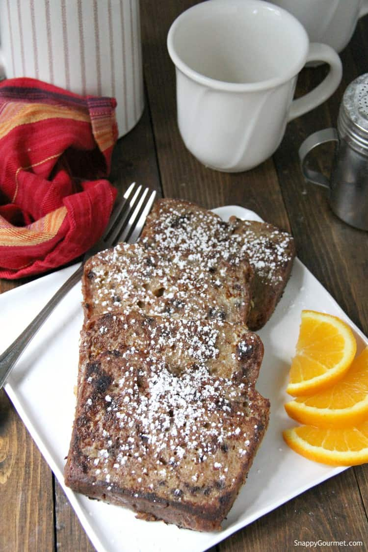 Cannoli French Toast slices on plate with orange slices
