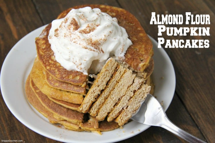 fluffy almond flour pancakes cut open with fork