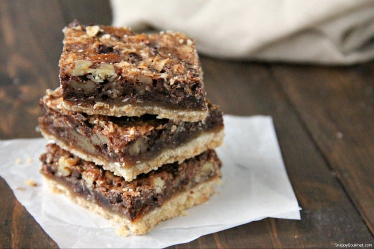 German Chocolate Pie Bars stacked on parchment paper