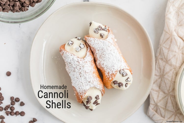 cannoli shells filled with cannoli cream and chocolate chips on plate