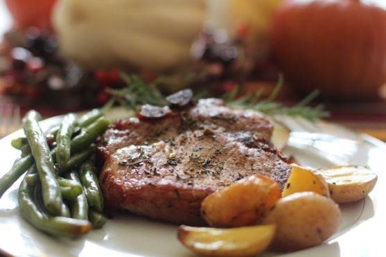 Pork Chops with Rosemary and Apples by Angela Roberts