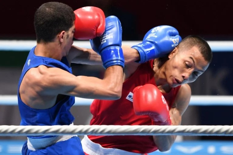 Asian Games  PH boxer Fernandez suffers KO vs Iraqi   Inquirer Sports Jaafar Abdulridha Ali Al Sudani of Iraq  in blue  competes against Mario  Fernandez of the Philippines  in red  during the men s bantam 56kg boxing  round of