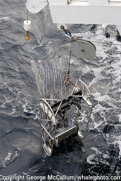 Plankton sampler being lowered into sea from research ship   George     MOCNESS Multiple opening and closing environmental sampling system deployed  from oceanographic research ship  Used to